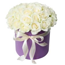 25 white roses in a hat box.