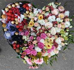 Gorgeous heart of flowers, chocolate and berries